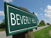 BEVERLY HILLS signpost along a rural road — Stock Photo