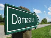 Damascus signpost along a rural road — Stock Photo