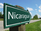 NICARAGUA arrow signpost along a rural road — Stock Photo