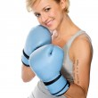 Woman wearing boxing gloves — Stock Photo #8686980