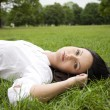 Woman laying on grass - Foto Stock