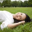 Womlaying on grass — Stock Photo #9996209