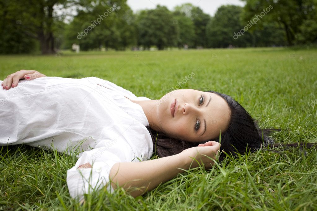 Woman laying on grass  Stock Photo #9996195