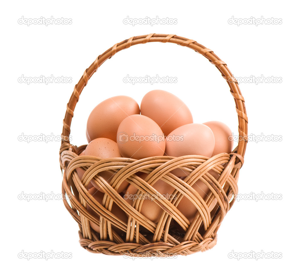 Eggs of hen in wickerwork basket isolated on white  Stock Photo #8484509