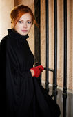Young beautiful woman next to the gate — Stock Photo
