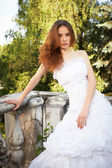 Bride posing on old stairs — Стоковое фото