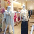 Stock Photo: Shop window with mannequins