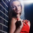 Beautiful young woman in a red dress — Stock Photo