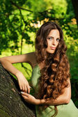 Portrait of beautiful woman with long curly hair — Stock Photo