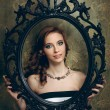 Pretty woman holding an empty frame — Stock Photo
