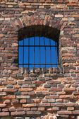 Old broken grated window — Stock Photo