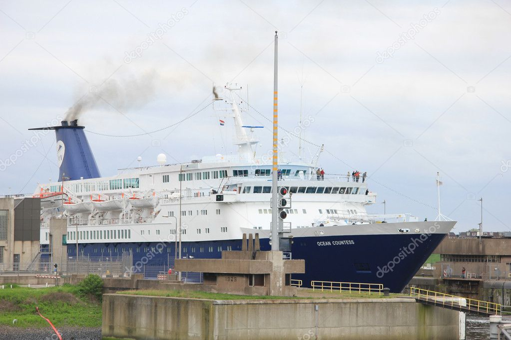 May 5th, 2012 Velsen, the Netherlands. Ocean Countess leaving the IJmuiden locks  Stock Photo #10480040