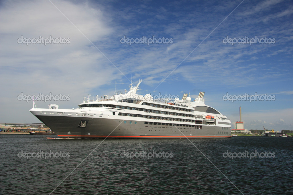 Small cruise ship sailing towards the sea  Stock Photo #10587198