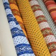 Rolls of Provencal textile on a market stall — Foto Stock