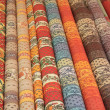 Rolls of Provencal textile on a market stall — Stock Photo #10636839