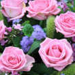 Pink and purple rose arrangement — Stock Photo