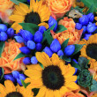 Sunflower arrangement in blue and yellow — Stock Photo #8612140
