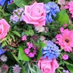 Mixed floral arrangement after rain shower — Stock Photo
