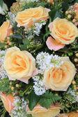 Soft orange roses in flower arrangement — Stock Photo