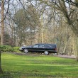 Hearse on a cemetery — Stock Photo