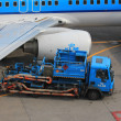 Stock Photo: March, 24th Amsterdam Schiphol Airport fueling airplane