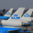 March, 24th Amsterdam Schiphol Airport airplanes waiting on the — Stock Photo #9731414