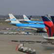 March, 24th Amsterdam Schiphol Airport airplanes waiting on the — Stock Photo #9732099
