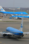 March, 24th Amsterdam Schiphol Airport Plane departing from gate — Stock Photo