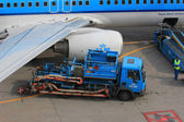 March, 24th Amsterdam Schiphol Airport fueling an airplane — Stock Photo