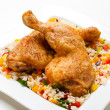 Roasted chicken legs, rice and vegetables — Stock Photo