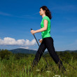 Nordic walking - active woman outdoor — Stock Photo #10105291