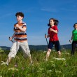 Nordic walking - active family outdoor — Stock Photo #10105354