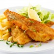 Fish dish - fried fish fillet, French fries with vegetables — Stock Photo #10531848