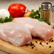 Raw chicken breasts on cutting board — Stock Photo #10651029