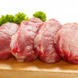 Raw pork on cutting board and vegetables - Stockfoto