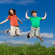 Girl and boy running, jumping outdoor — Stock Photo