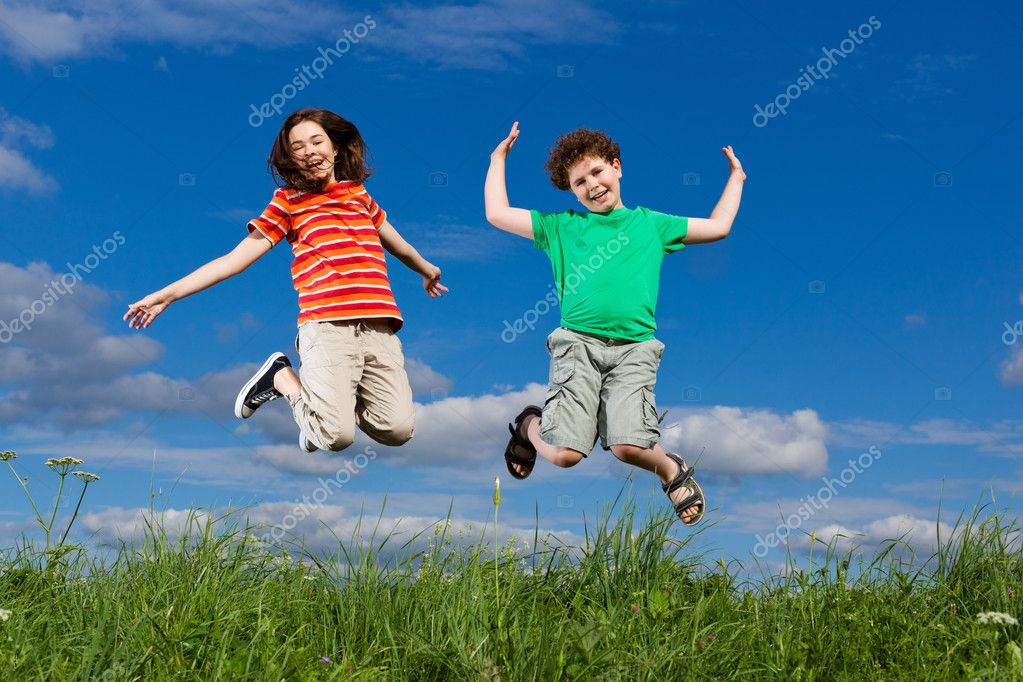 Kids jumping, running outdoor  Stock Photo #8410742