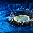 Lemon splashing in water - Stock Photo