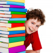Boy behind pile of books isolated on white background - Stock Photo