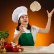 Girl making pizza dough — Stockfoto