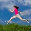 Girl jumping, running against blue sky — Stock Photo #8595076