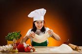 Girl making pizza dough — Stock Photo