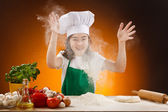 Girl making pizza dough — Stock Photo