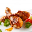Royalty-Free Stock Photo: Roast chicken drumsticks and vegetables