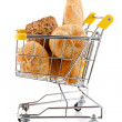 Shopping trolley full of bread and rolls on white background — Stock Photo #8611812