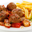 Stock Photo: Roasted meatballs, French fries and vegetables