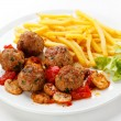 Roasted meatballs, French fries and vegetables — Stock Photo