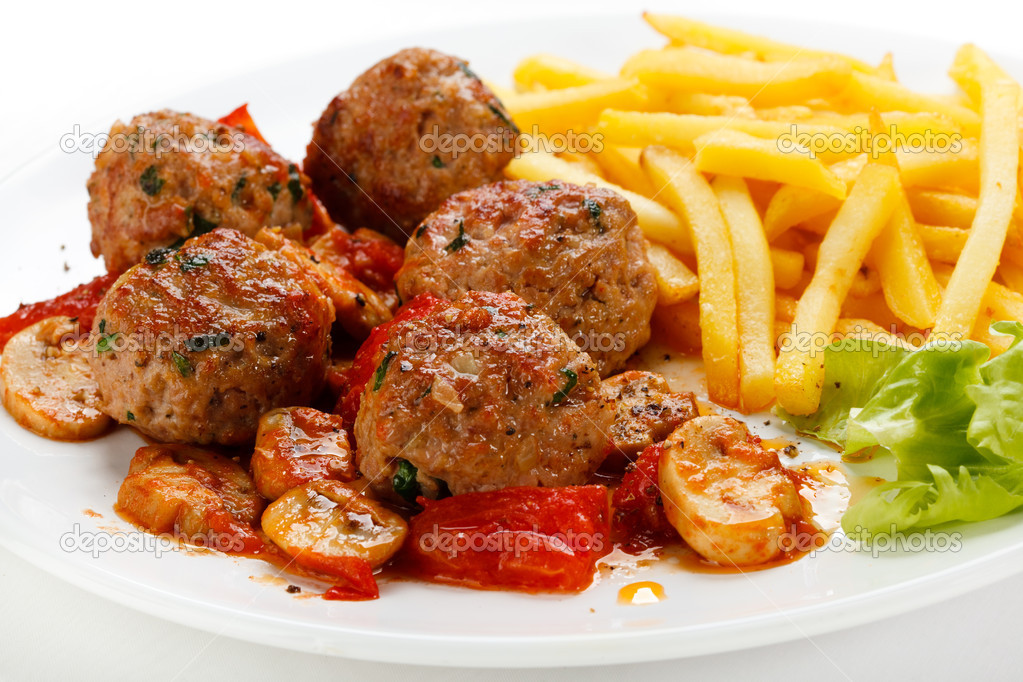 Roasted meatballs, French fries and vegetable salad   Stock Photo #8644986