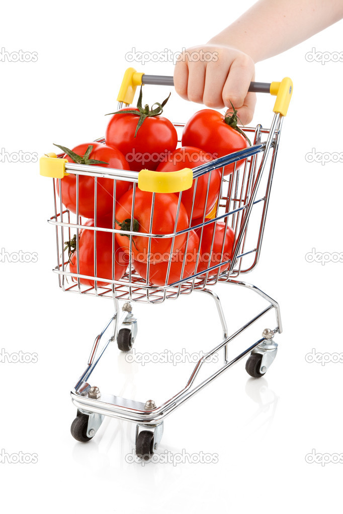 Shopping trolley full of tomatoes on white background — Stock Photo #8672695