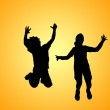 Silhouette of jumping girl and boy — Stock Photo